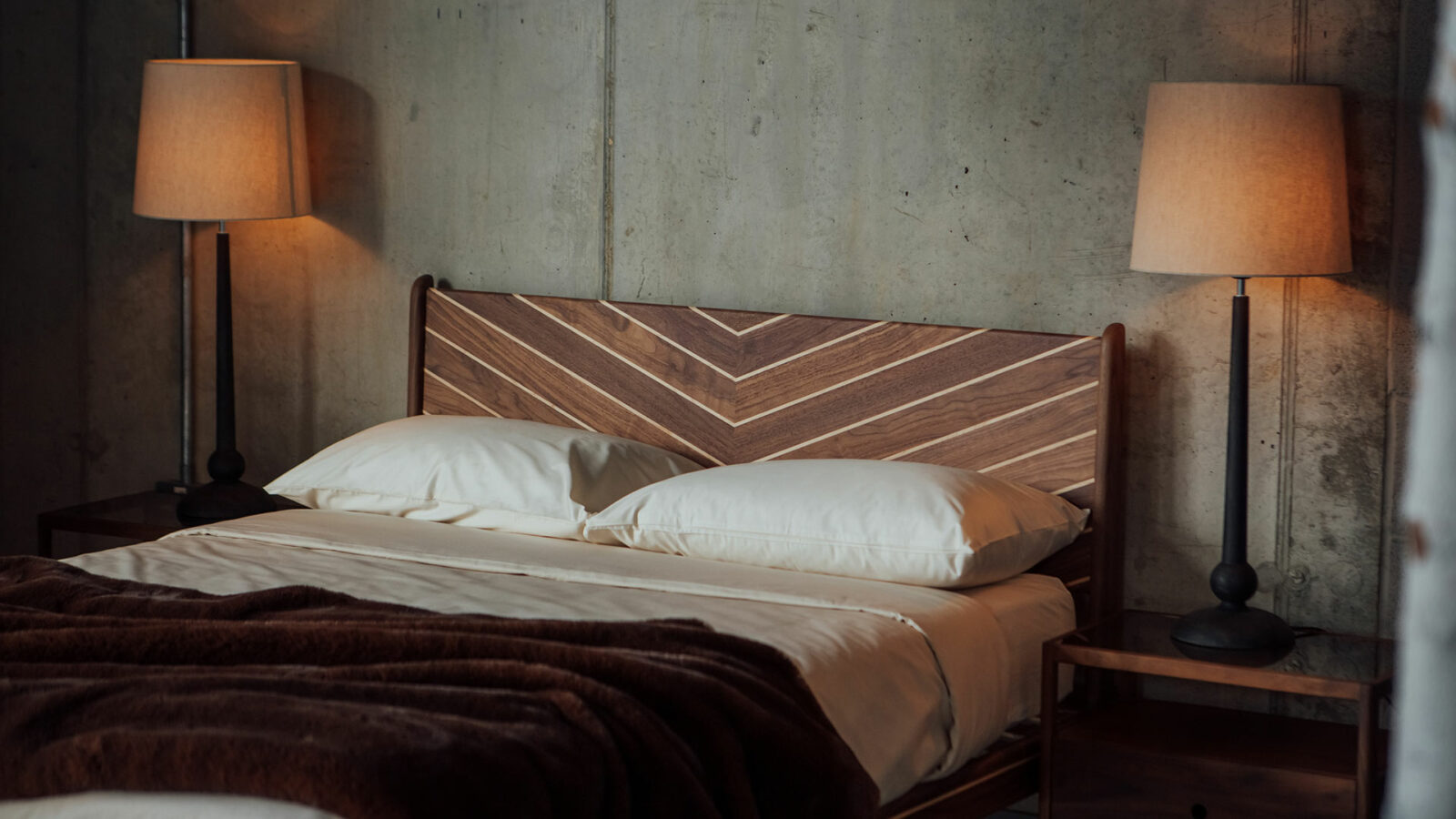Hand-made in Britain our Special edition Hoxton bed with chevron patten headboard in walnut and maple.