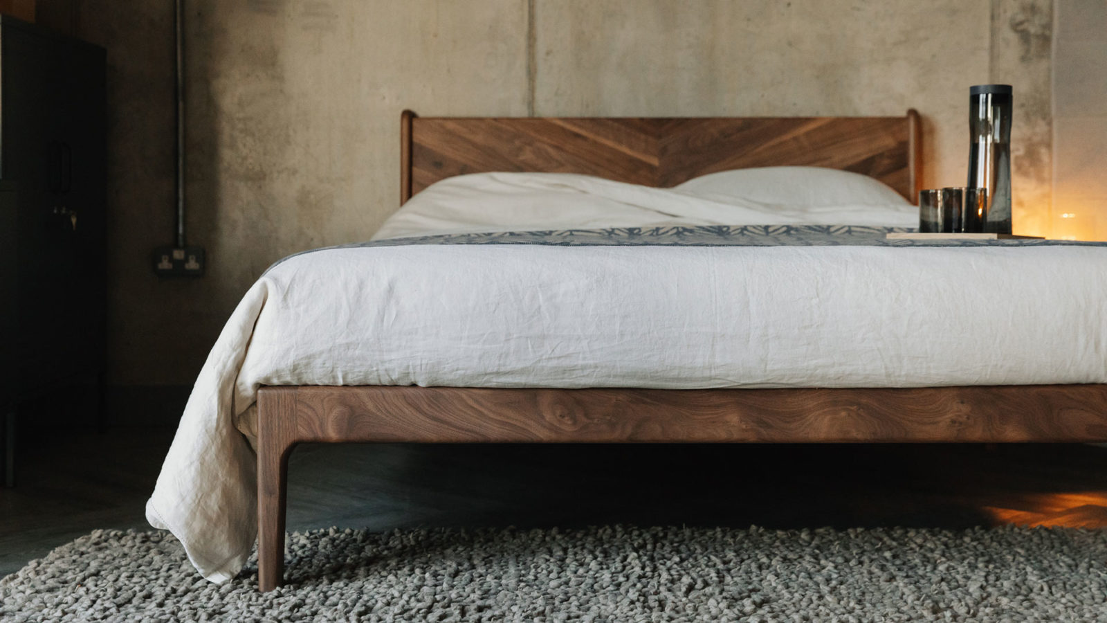 Hoxton bed in solid walnut with linen bedding