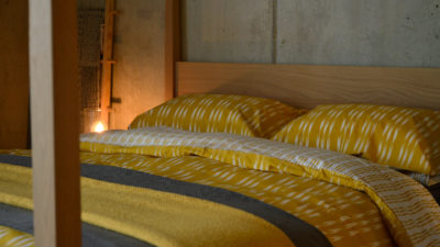 ikat-stripe-duvet-set-in-ochre-with-lace-throws