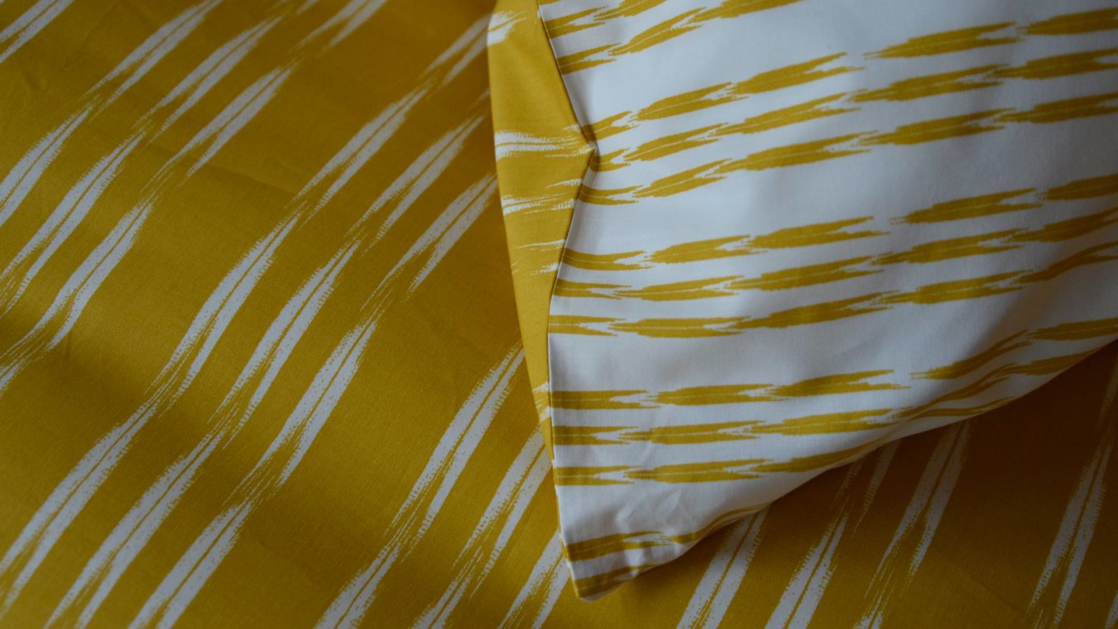 ikat-stripe-pattern-detail-in-ochre-and-white