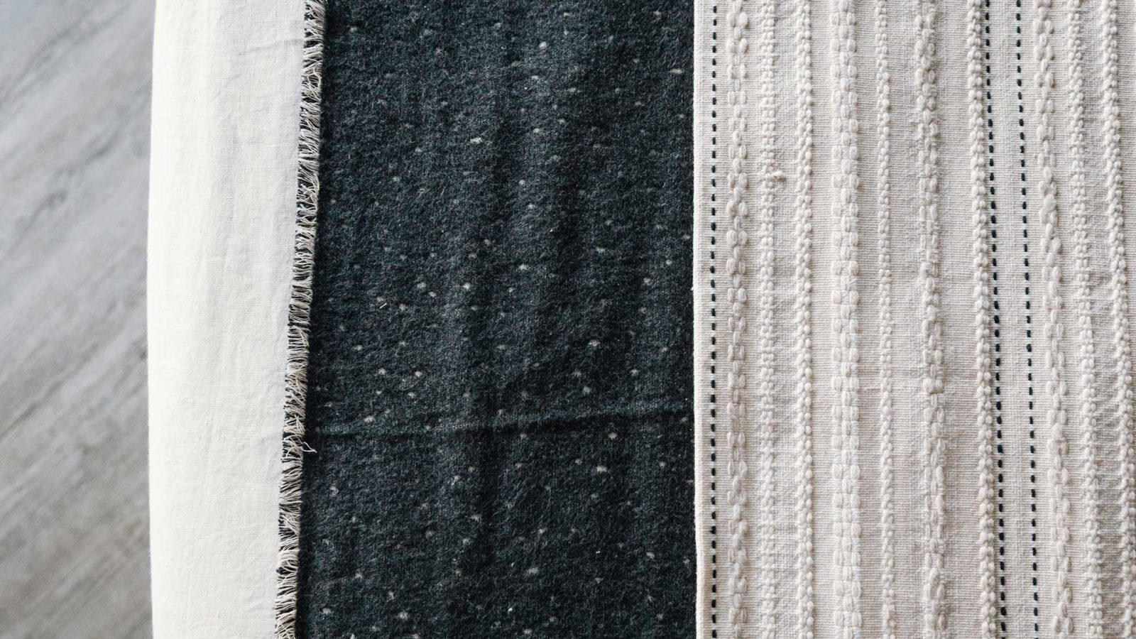 embroidered throw in ivory