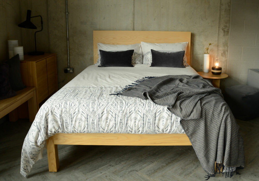 grey and ivory printed duvet cover set shown on a king size wooden bed