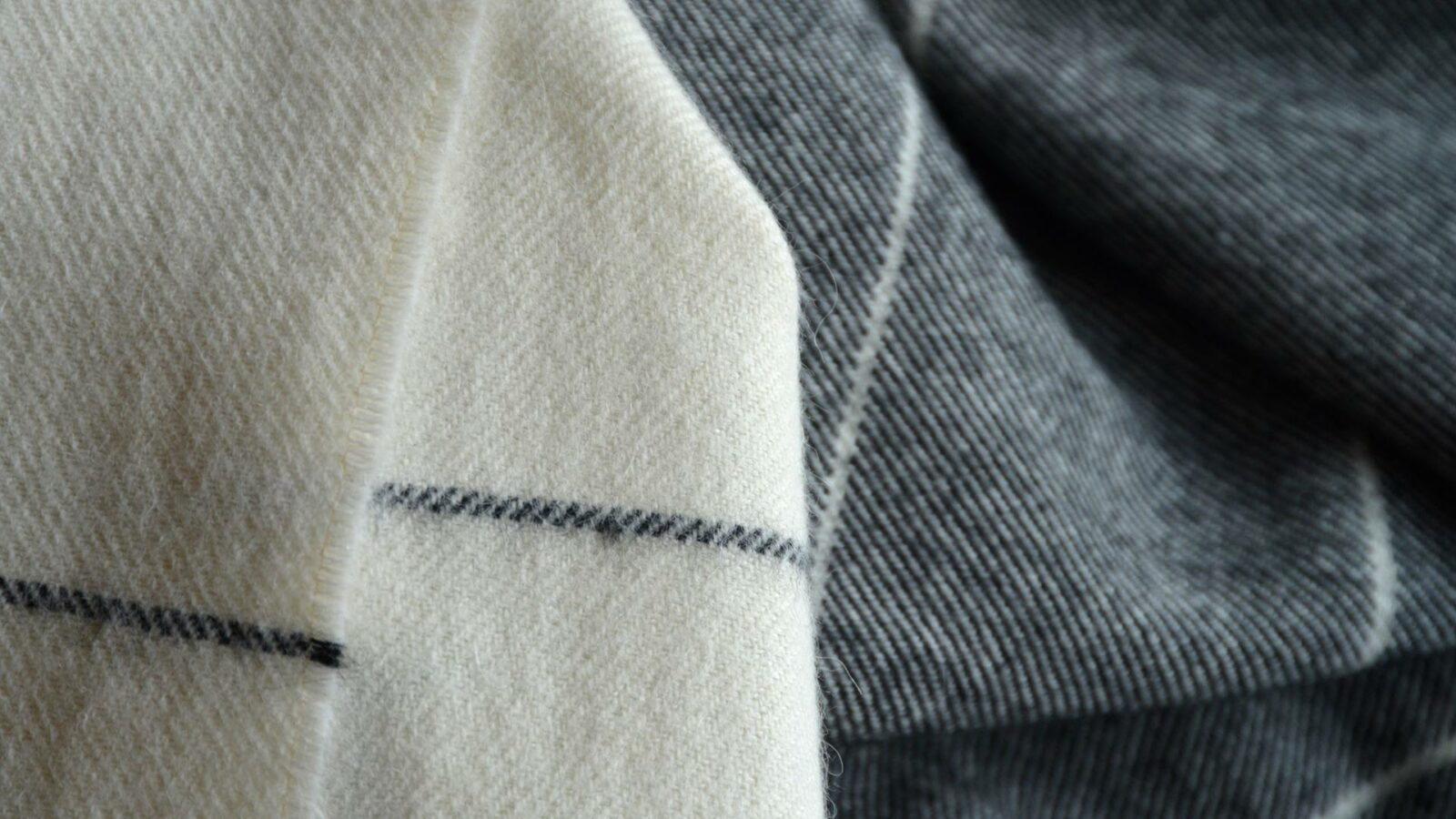 charcoal and ivory stripe alpaca and merino wool throw a close up view
