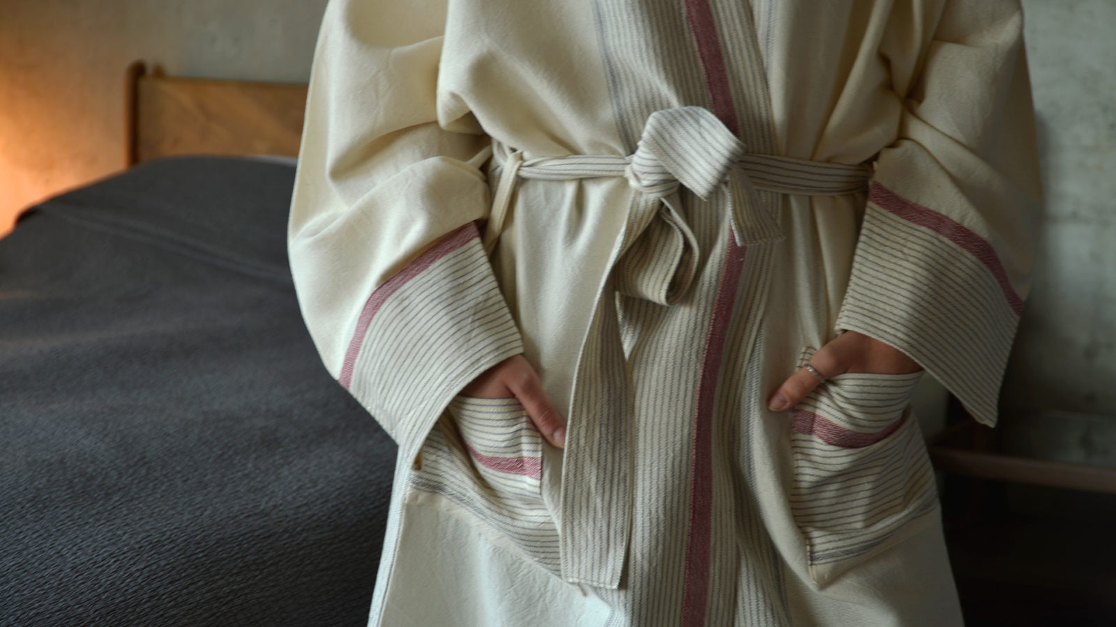 ivory soft cotton dressing gown with striped details a closer view