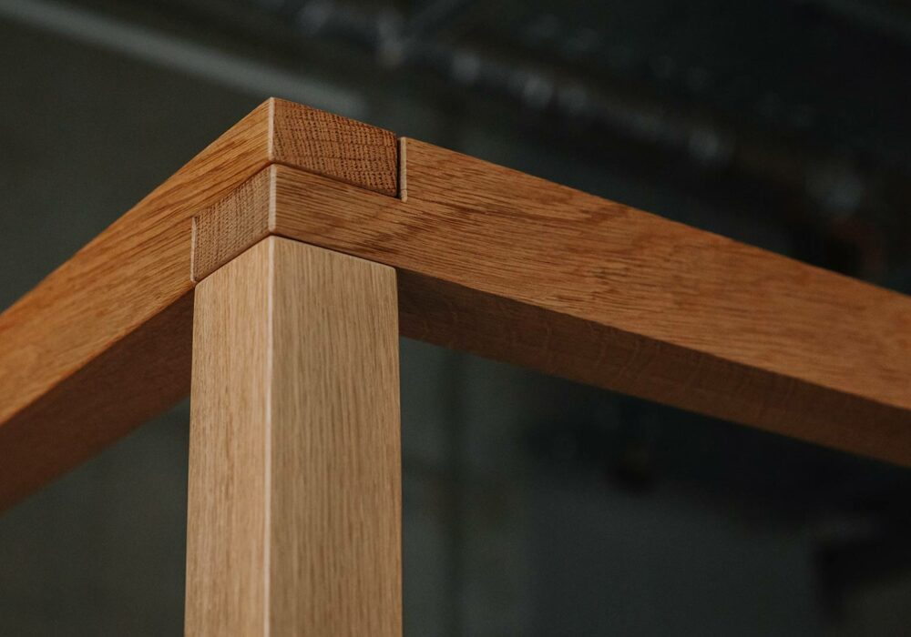 A close up view of the upper frame of the hand crafted Kelham 4 Poster bed in solid oak
