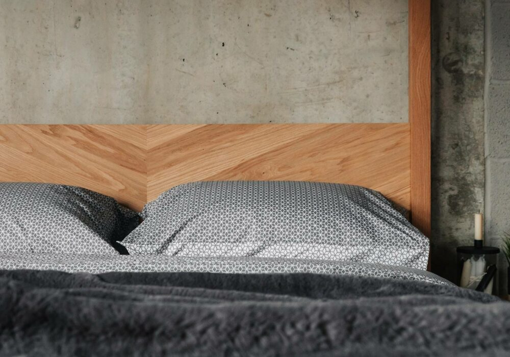 The headboard of our solid wood hand made Kelham 4 poster bed has a chevron pattern
