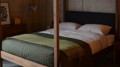 Khaki Green Geometric Stitch Quilt on the walnut Highland upholstered 4 poster bed