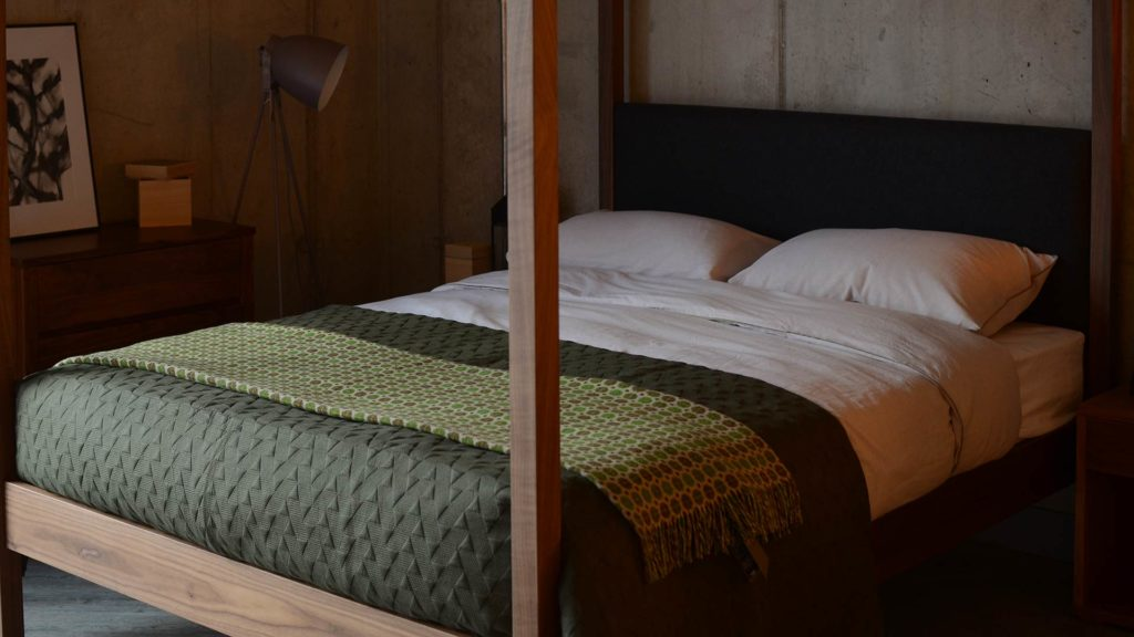 Khaki Geometric Bedspread & Chambray Duvet on our Highland 4 Poster wooden bed