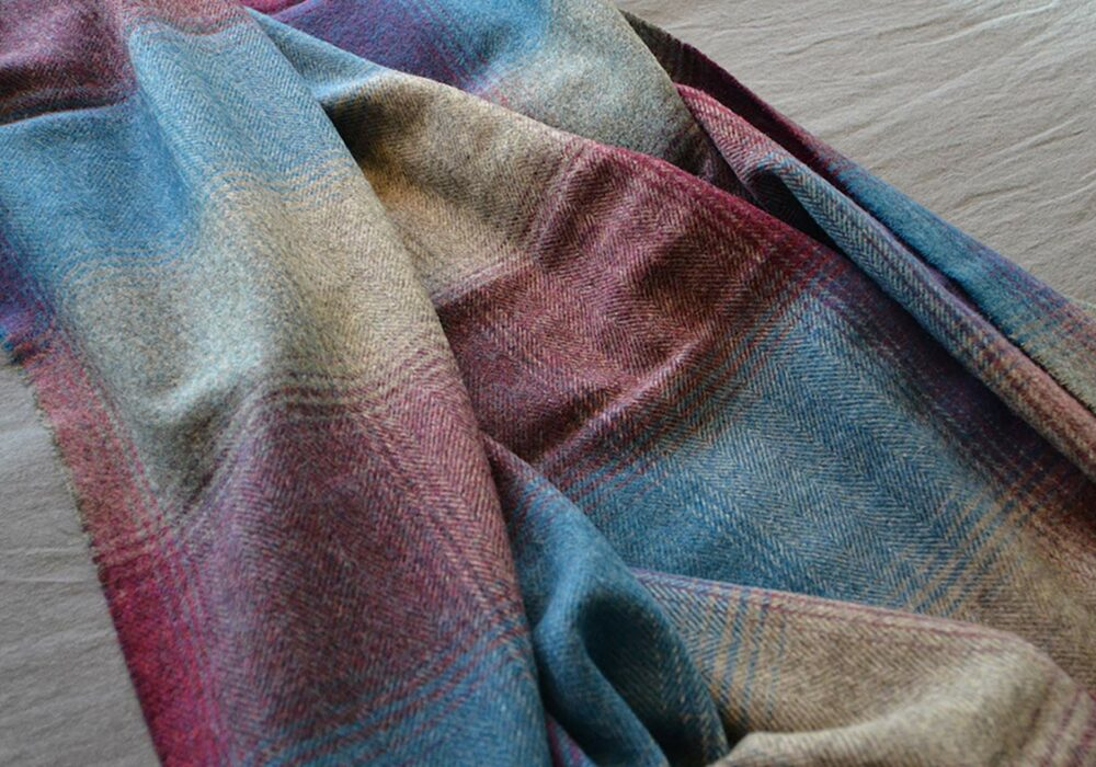 classic lambswool throw in grey, blue and wine coloured check