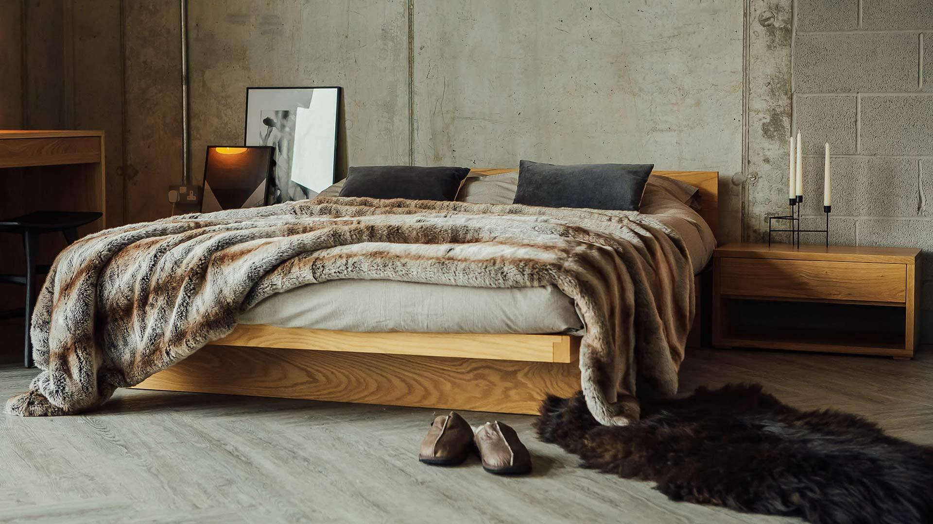 Luxurious faux-fur bedspread draped across a King size Kyoto bed in Oak