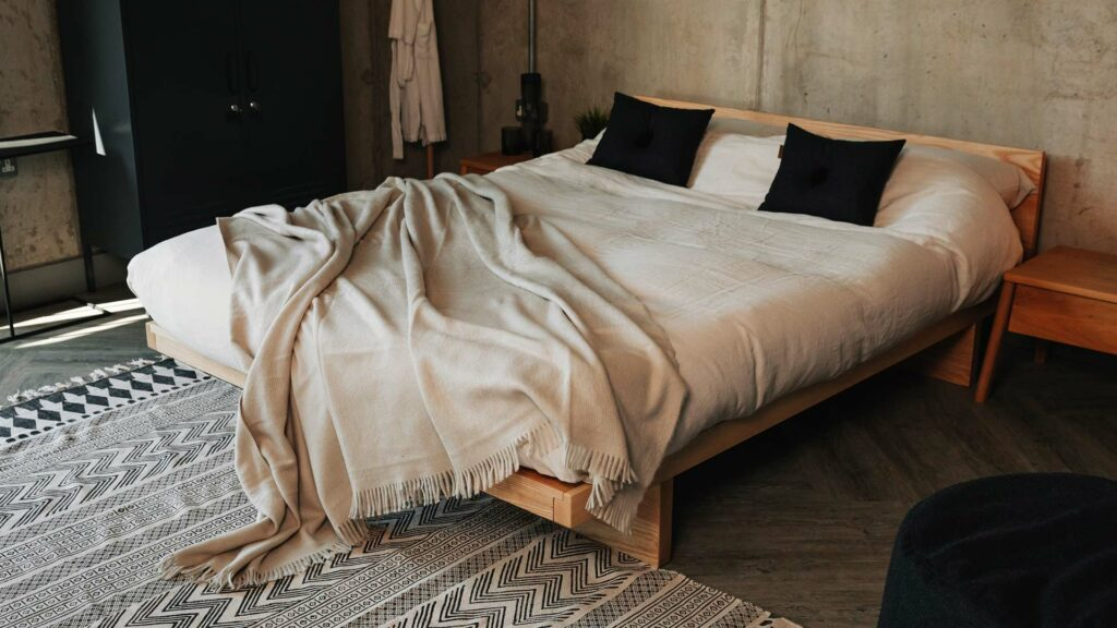 Ash Kyoto with headboard pictured with a Monochrome rug