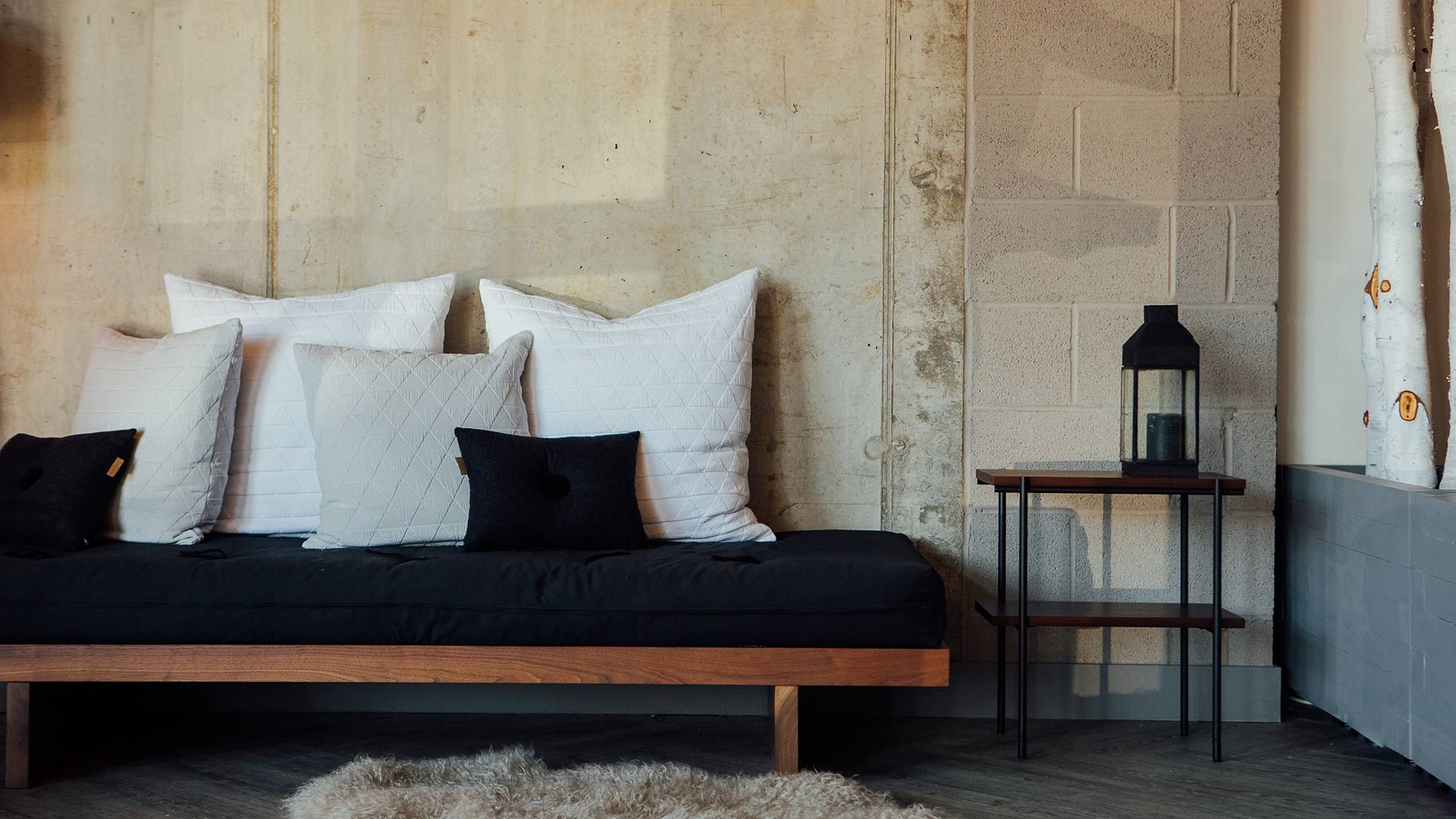 Kyoto spare bed or Daybed, a solid wood frame in Walnut with futon mattress