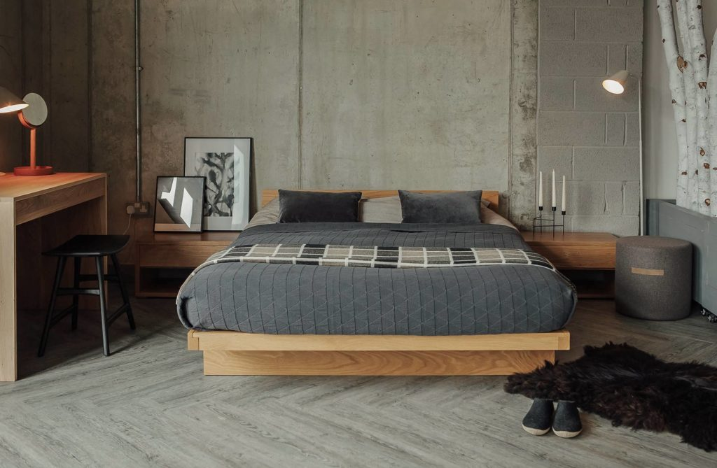 Industrial look bedroom with solid Oak Kyoto bed and grey bedding.