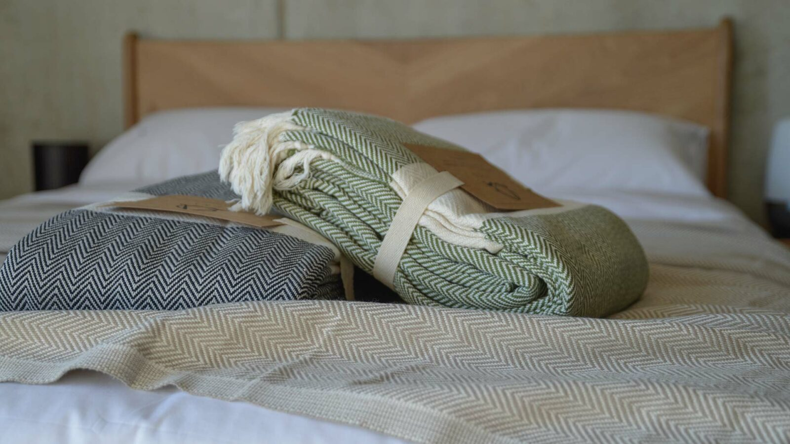 ethically made woven cotton blankets with herringbone weave and in 3 colour options