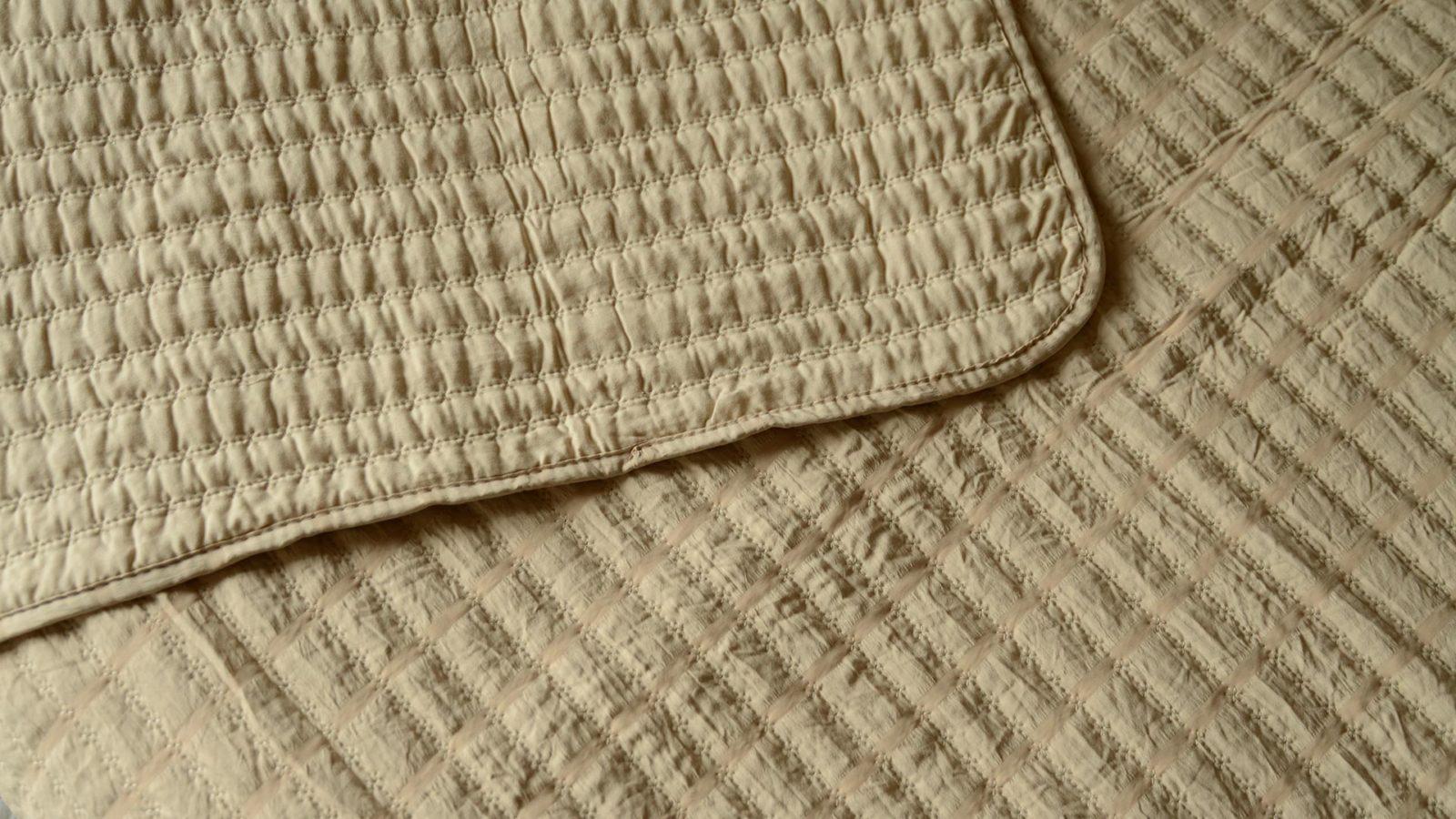 reversible bedspread in sand