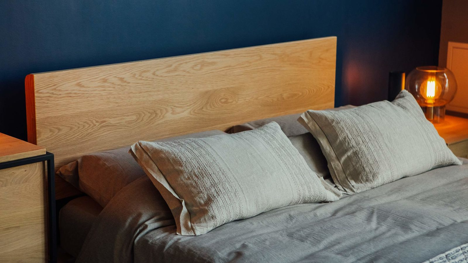 A closer view of the wooden Malabar bed headboard in Oak