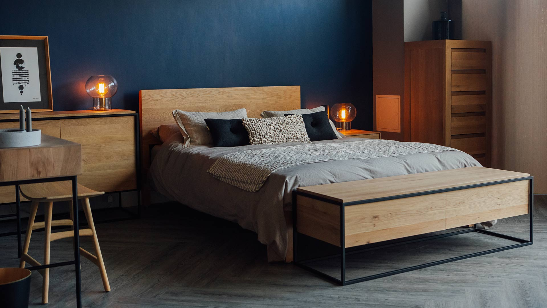 Our hand made Malabar bed in Oak shown with Ethnicraft Monolit storage furniture