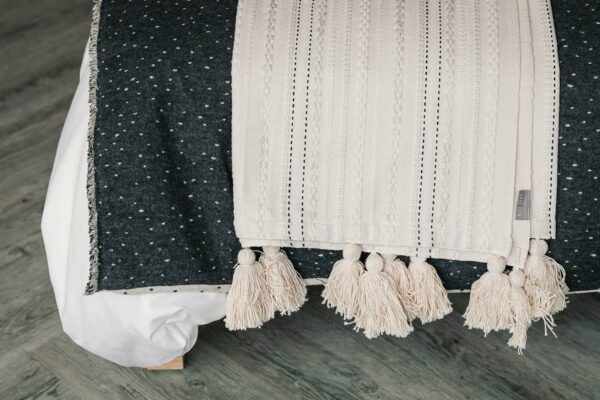 embroidered ivory throw with tassels