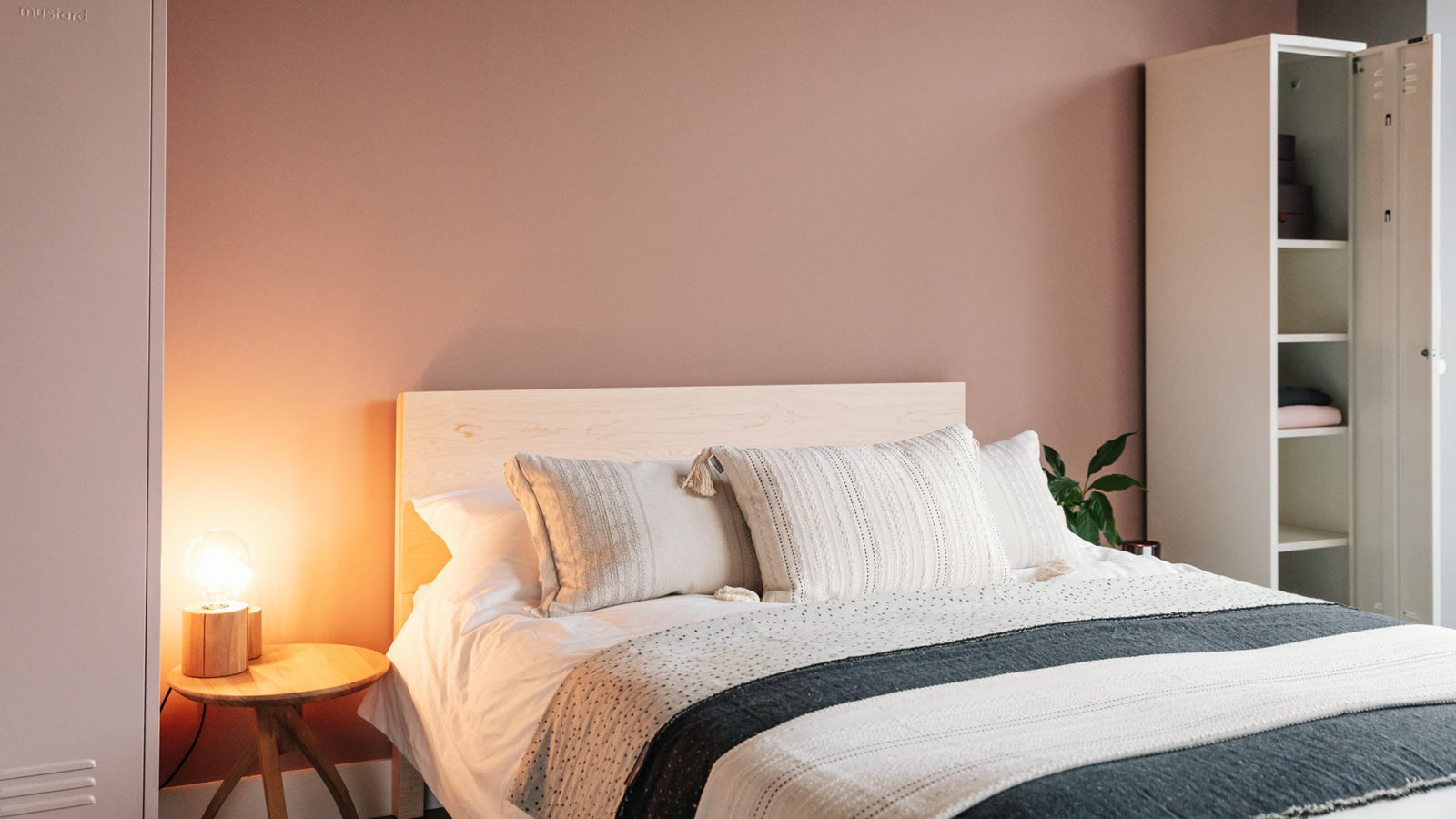 Blush pink bedroom with Maple Malabar solid wooden bed
