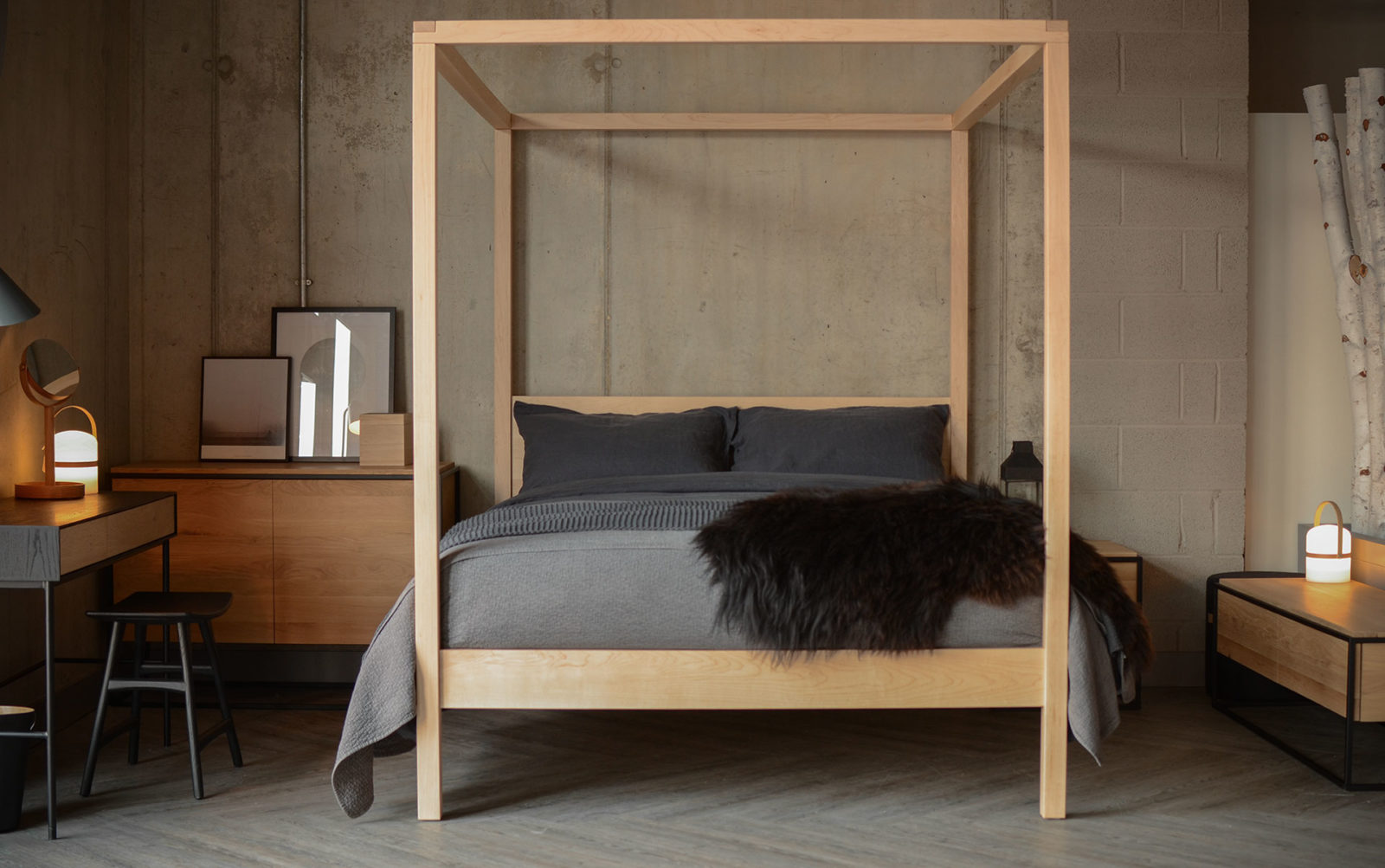 A monochrome colour scheme and pale maple wood Orchid 4 poster bed give this room a Scandi look