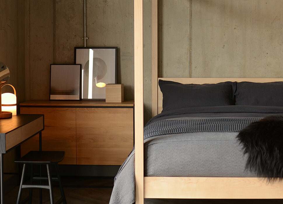 Dark accents and natural timbers for a Scandinavian style bedroom featuring our wooden 4 poster Orchid bed