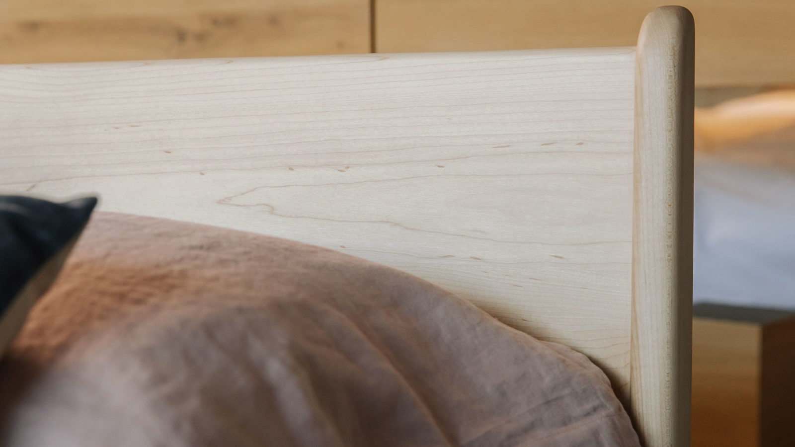 close up of the hand crafted pimlico bed headboard in Maple