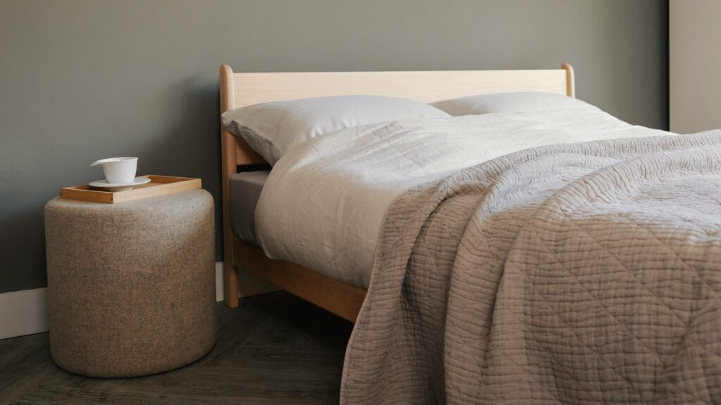 Side view of the pimlico contemporary low bed in solid maple