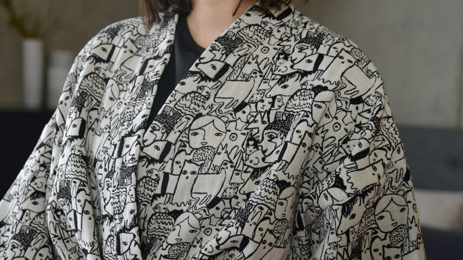 Donna Wilson black and white woven characters design robe, a close up view