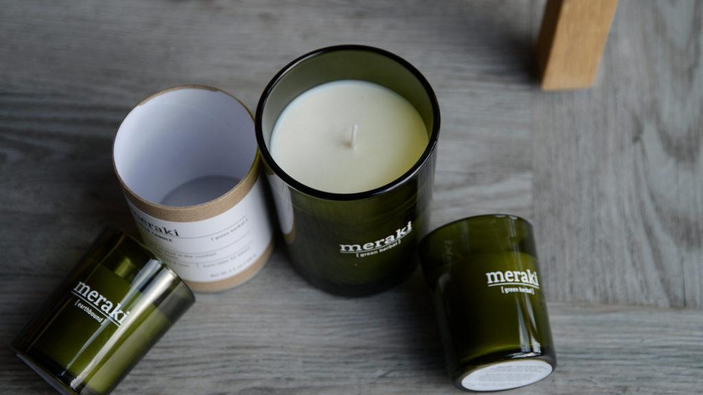 Meraki scented candles in green glass jars