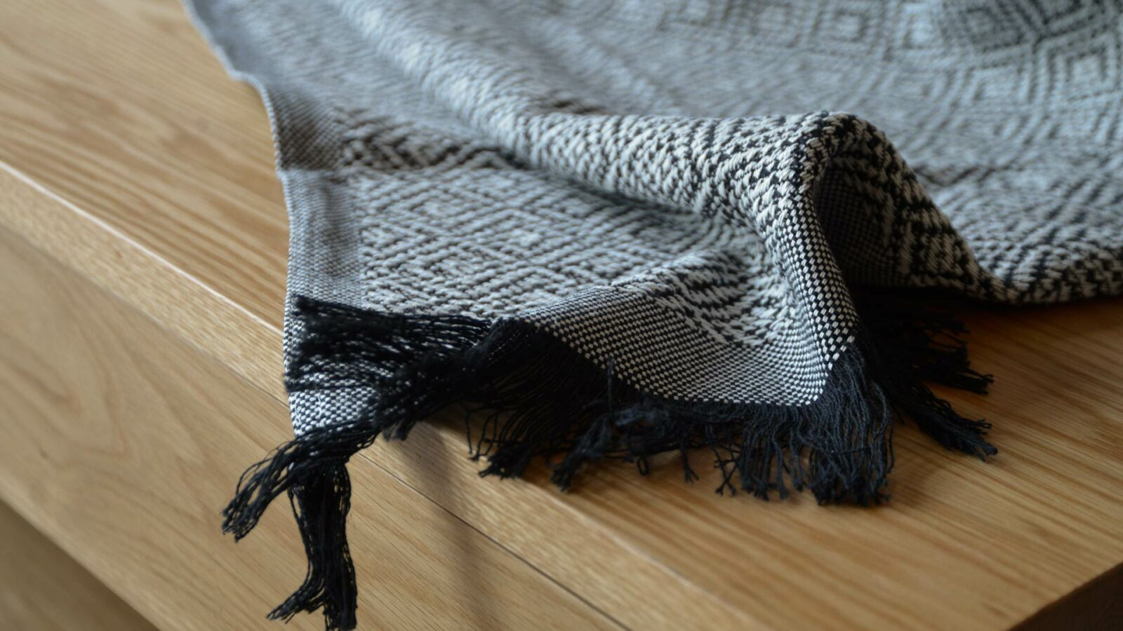 cotton rich woven diamond pattern throw in black and white
