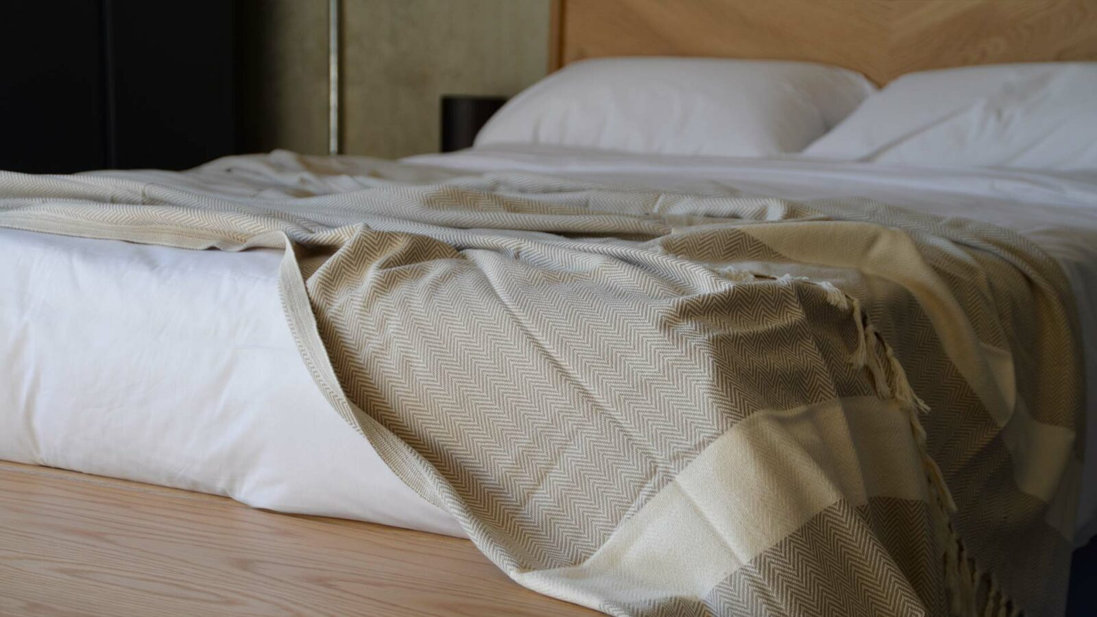 OEKO TEX certified woven cotton blanket with herringbone weave in taupe and cream