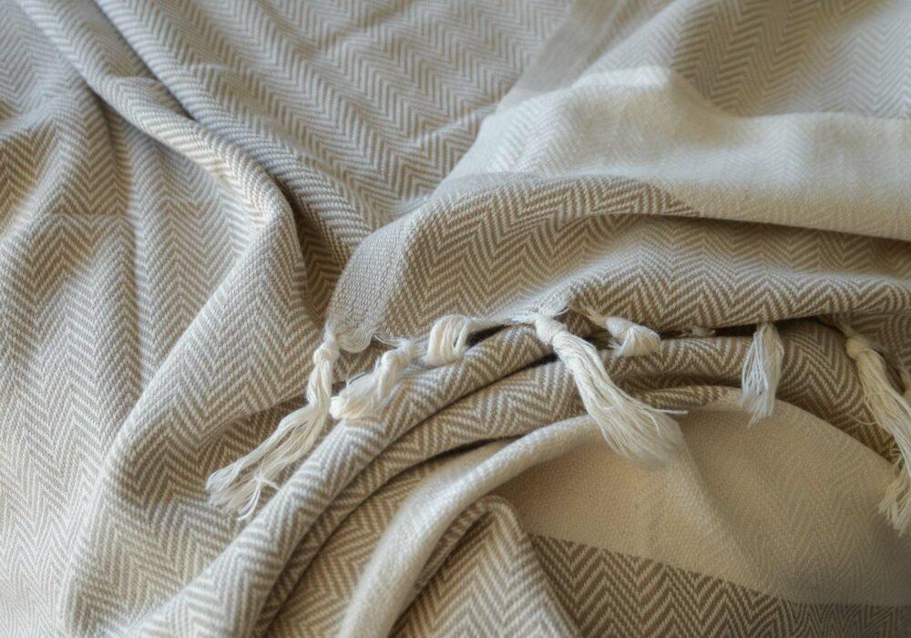 OEKO TEX certified woven cotton blanket with herringbone weave in beige and cream