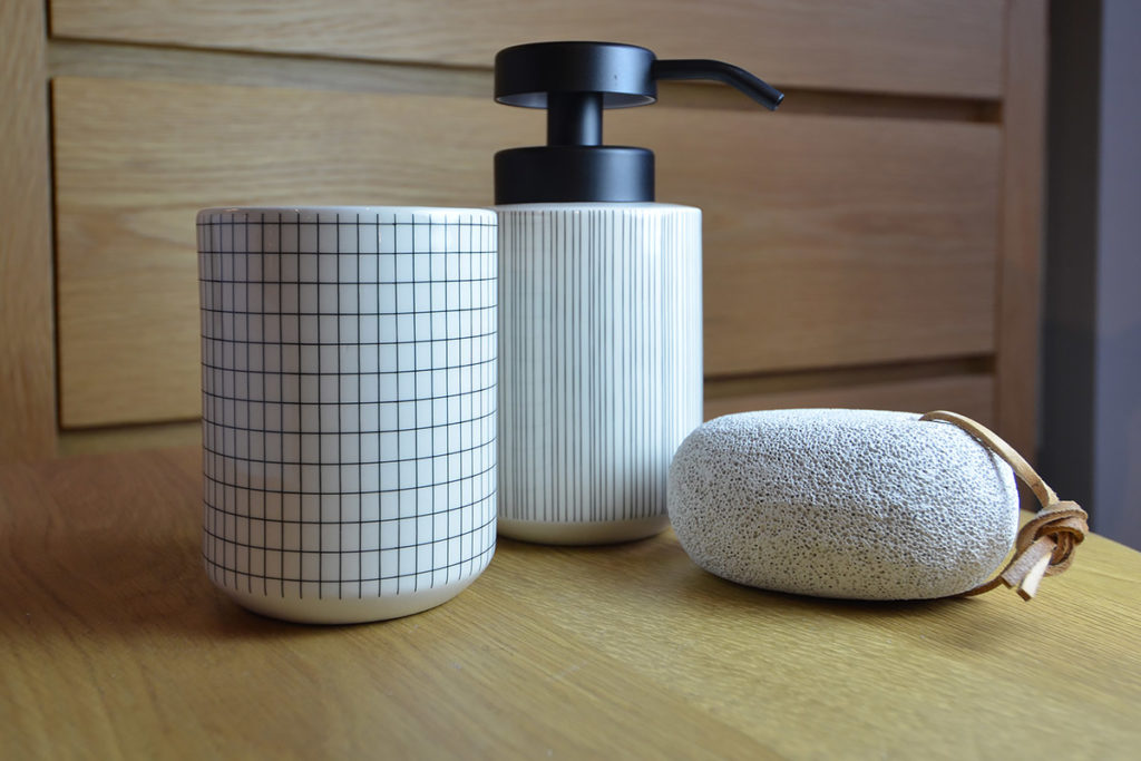 modern bathroom accessories available from Natural Bed Company. Including the grid-pattern tumbler and striped soap dispenser.