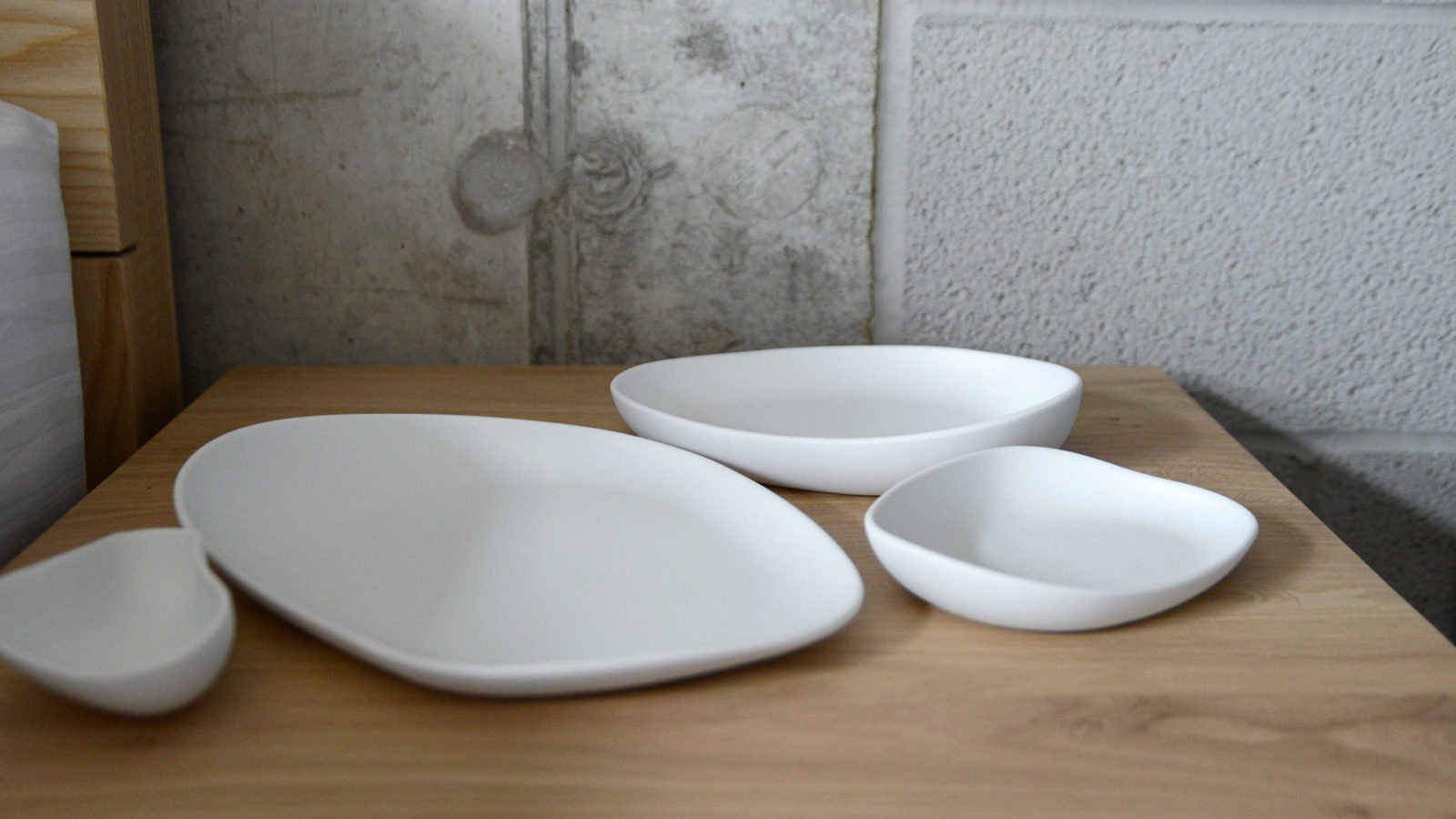a set of matte white porcelain dishes