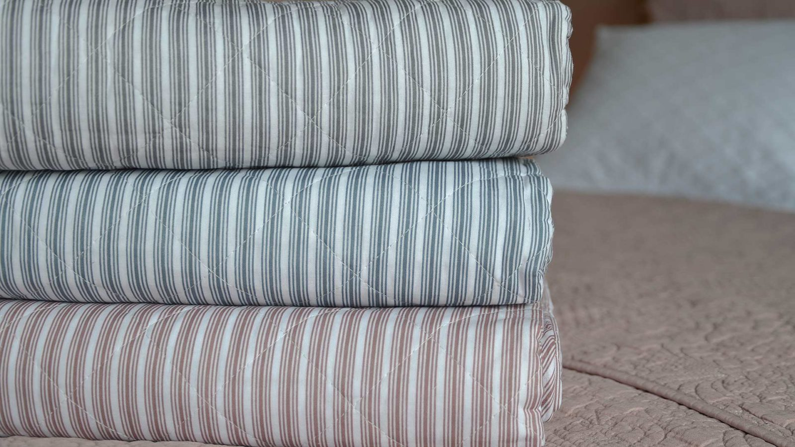 Multi-stripe cotton quilted blankets