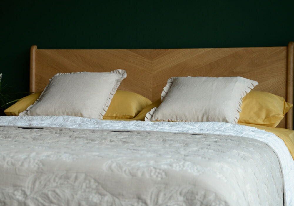 reversible embroidered quilted bedspread in sand and ivory
