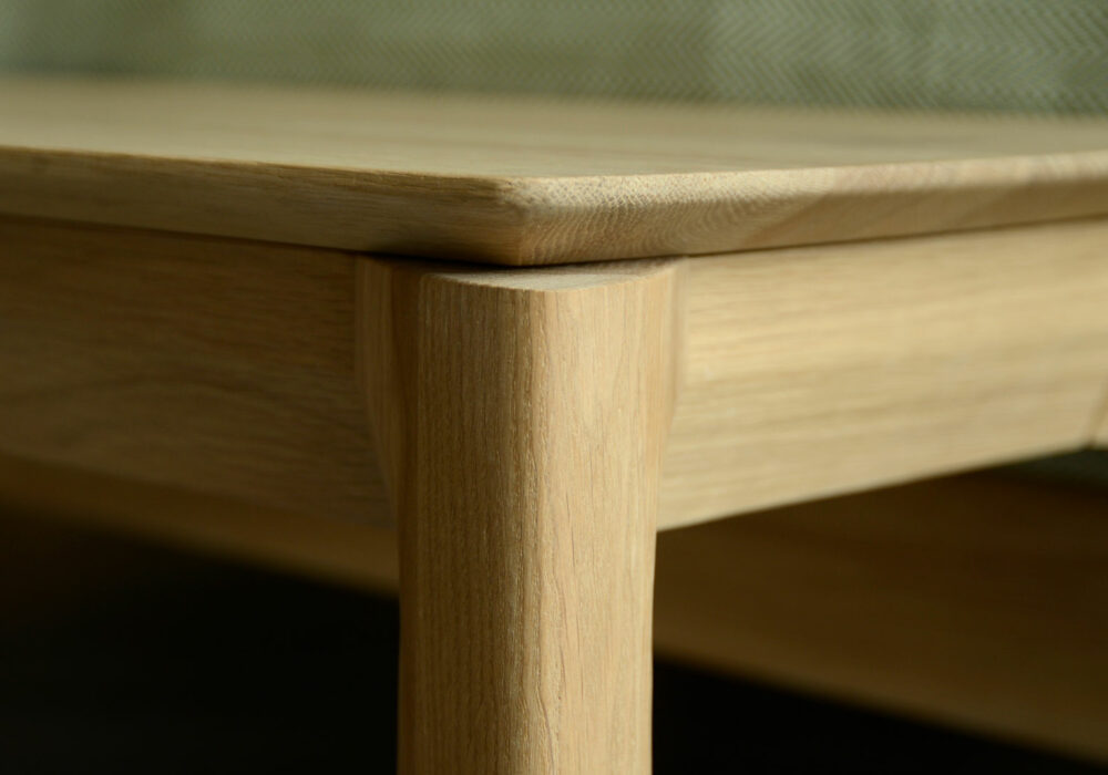 natural finish solid oak bench or end of bed table a detail view