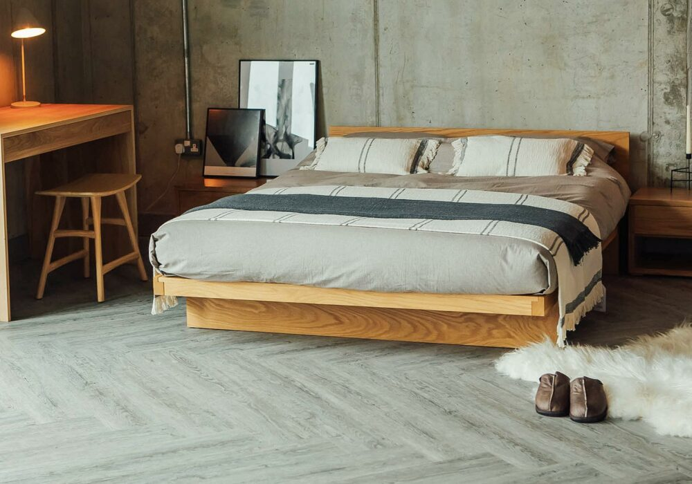 Our Solid oak Kyoto bed in Kingsize with Wave table and low cube bedsides.