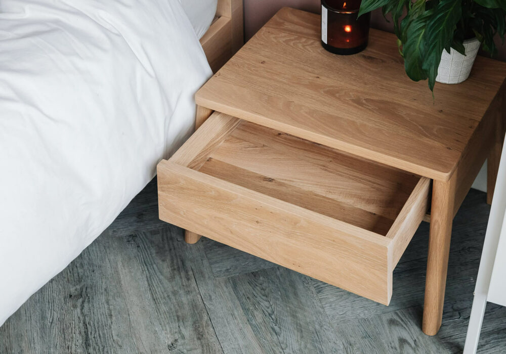 Air solid oak bedside table with open drawer