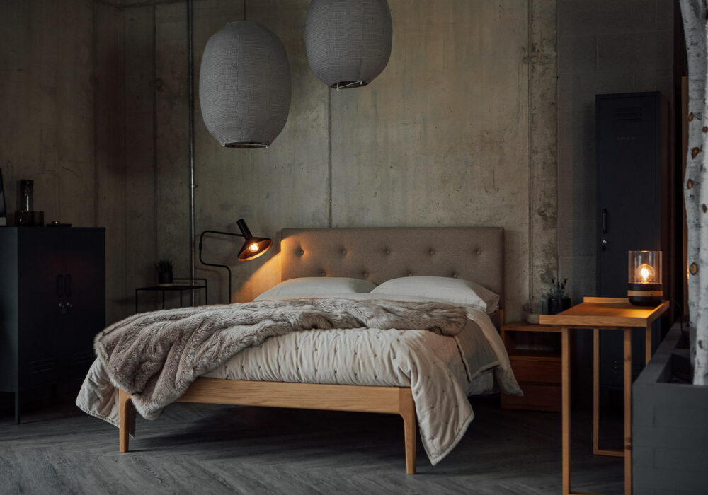Industrial bedroom style made cosy with our upholstered headboard Bloomsbury bed in oak.