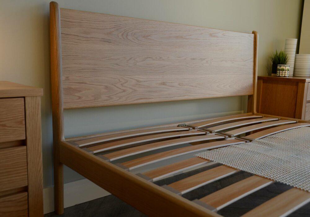 A view of the handmade oak Camden bed headboard shown without mattress