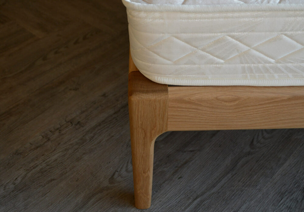 A close look at the hand crafted Camden wooden bed leg in solid Oak