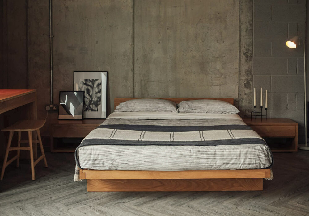 Scandi inspired bedroom featuring our Oak Kyoto bed with ivory and grey bedding
