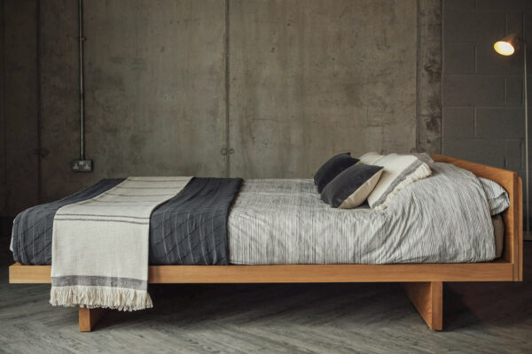 A side view of our solid wood Kyoto bed in Oak and with an optional Headboard. Available in a range of bed sizes.