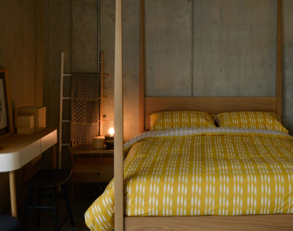 ochre bedding shown on our Hatfield wooden 4 poster bed made in Oak
