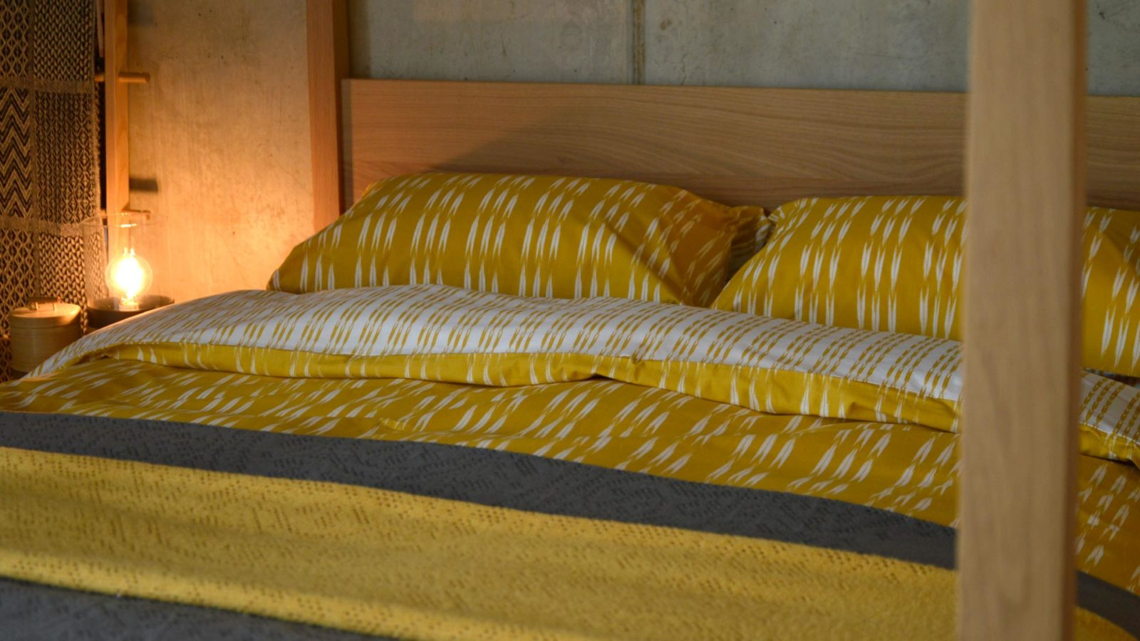 ochre-ikat-stripe-duvet-set-with-lace-throws