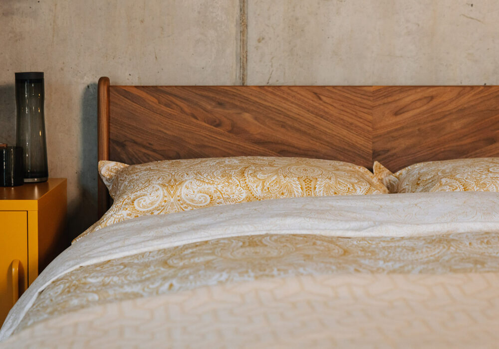 Hand crafted Hoxton bed in walnut with a chevron grain pattern