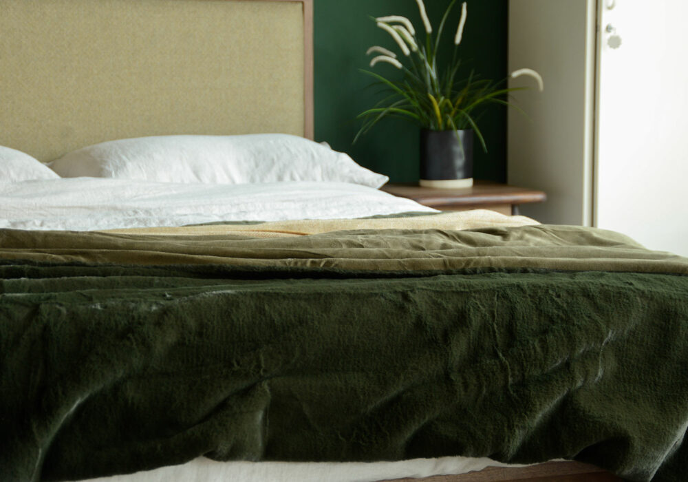 softest luxury faux fur bed throw in deep olive green