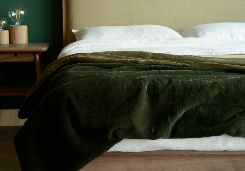softest luxury faux fur throw in deep olive green