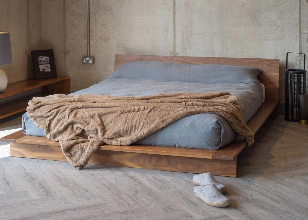 Modern low platform-style solid wood bed The Oregon, in rich luxurious Walnut wood